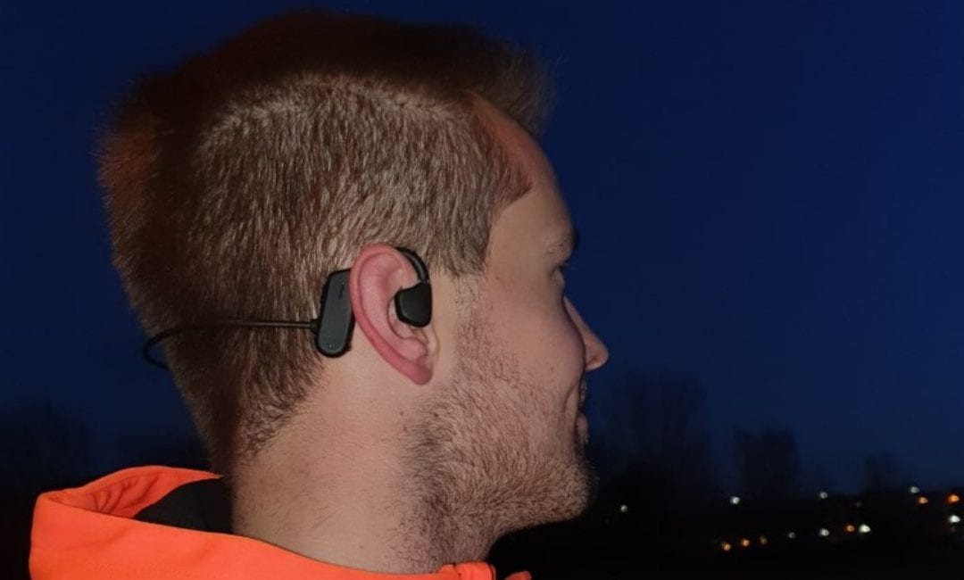 Glenn Siebens using the AXIWI bluetooth sport headset in the gym and while walking