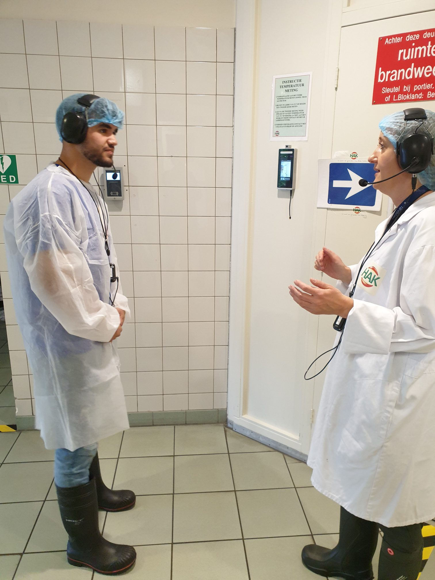 hak instructs staff with wireless factory headsets